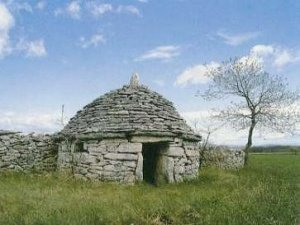 The kažun, a small stone house in the Istrian landscape.